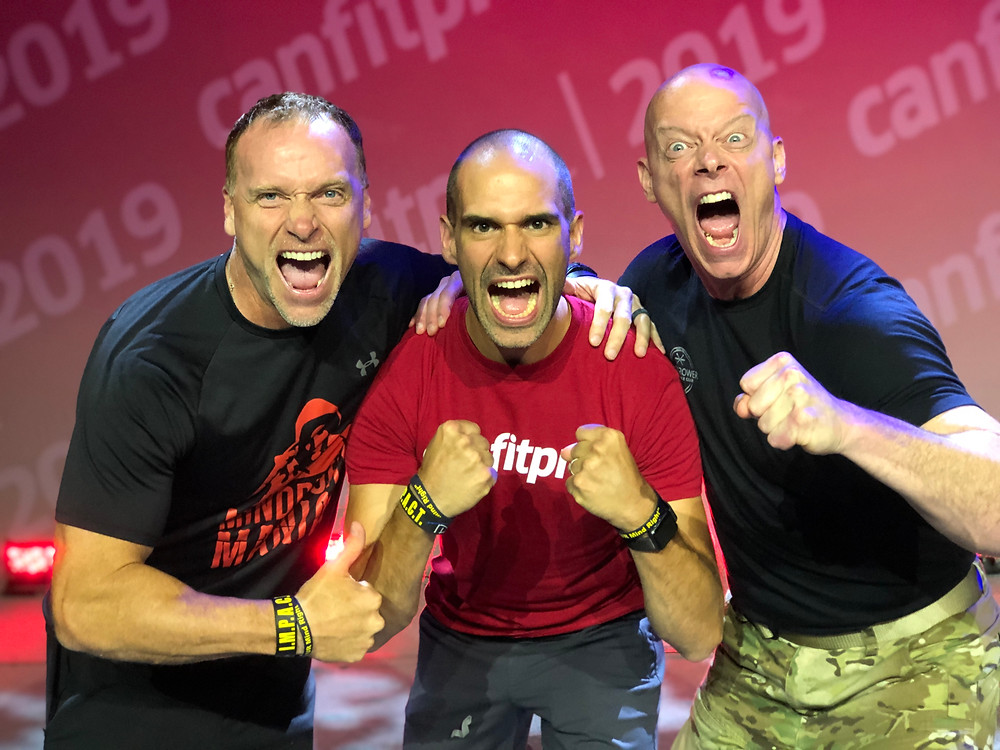 Surrounded by my mentors Sgt Ken and Todd Durkin at the 2019 Canfitpro Conference.