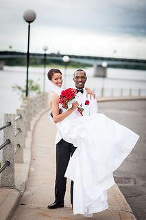 Groom holding Bride.jpg