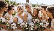bride and bridesmaids with bouquets_edit
