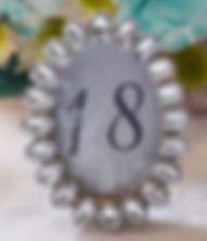 Sparkly oval table number.jpg