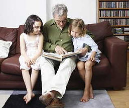 Children reading with grandparent