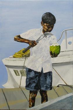 Boy cutting a coconut