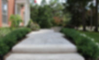 Front yard Landscape with Interlock Walkway, Driveway, retaining walls, armour stone, plantings, perennials, flowers, night lighting, landscape design, large flagstone