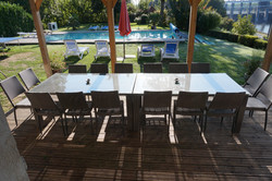 Dining terrace overlooking pool