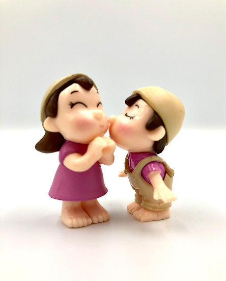 Boy & Girl Standing Kissing Figurine