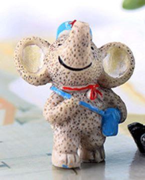 Elephant With Bag Figurine