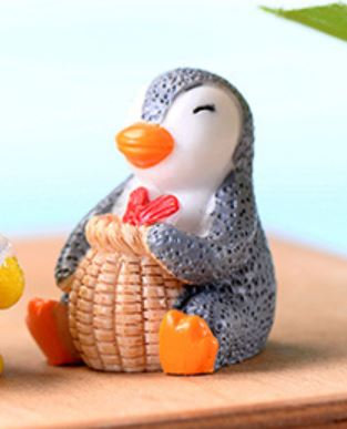 Penguin With Basket Figurine
