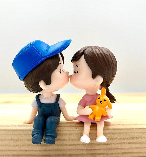 Boy & Girl Sitting up Kissing Figurine