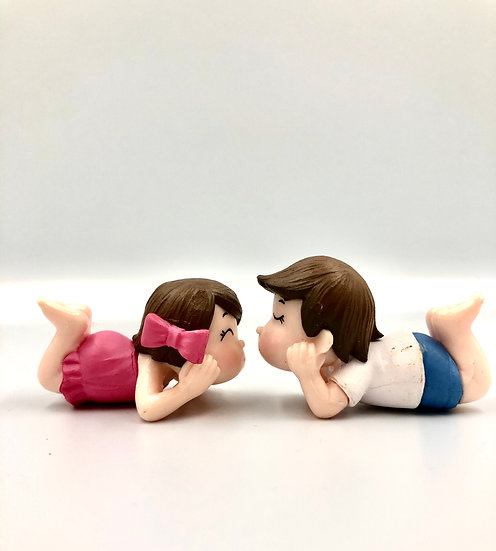 Boy & Girl Laying Down Figurine