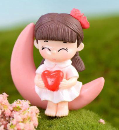 Girl Sitting On Moon Figurine