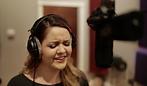Lindsay Callahan singing at the recording studio