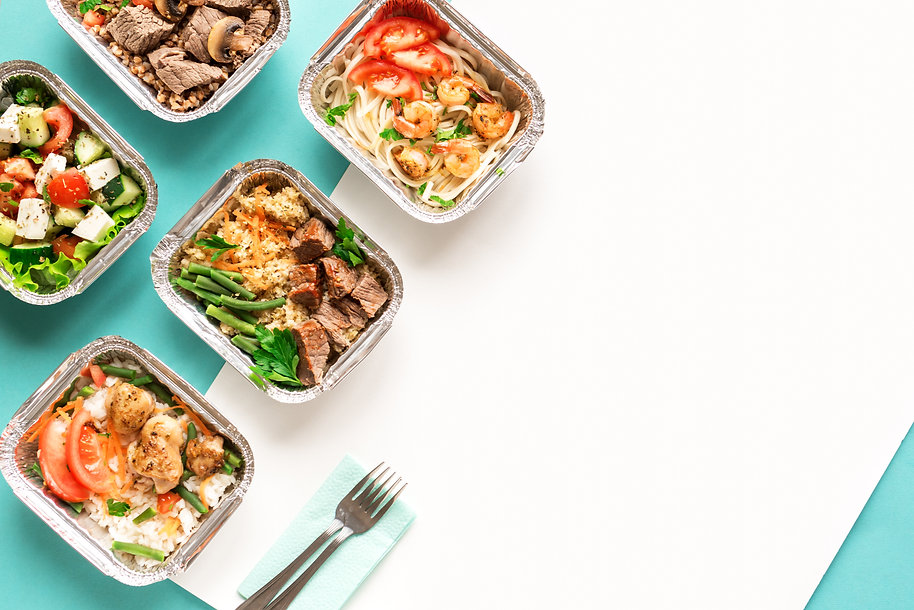 Healthy food delivery. Take away of organic daily meal on blue, copy space. Clean eating c
