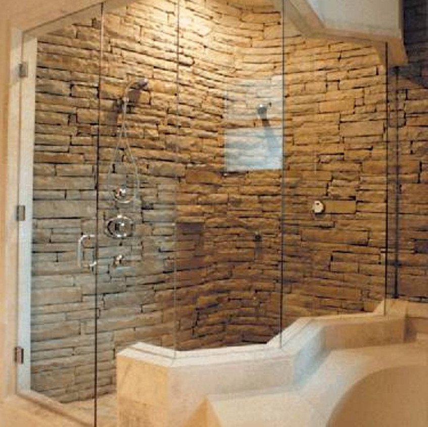 walk-in-shower-with-cultured-stone-wall-panel