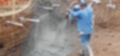 A builder sprays gunite to create a subu