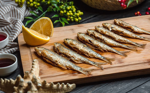 fried-fishes-set-on-wooden-board.jpg