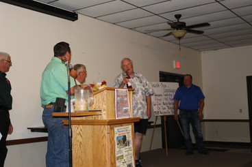 Jim Irwin gladly accepting his auction p