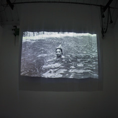 B&W 35mm photograph scans shown as video projection (with sound) onto opaque shower curtain. 180 cm x 180 cm 2018