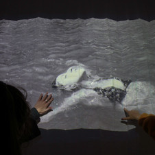 Video projection (with sound) onto shower curtain. Scented bath soap and water being rubbed into shower curtain. (180 cm x 180 cm) 1 min. 06 sec. (on loop) 2018