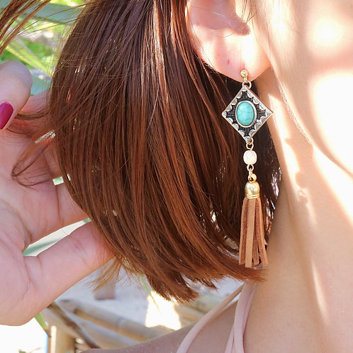 Turquoise stone with suede tassel earrings | modeled