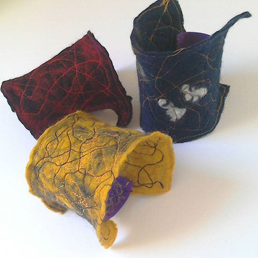 Selection of felt, stitiched cuffs. Made to order.