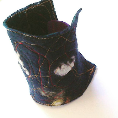 Handmade felt, stitched cuff. Made to order.
