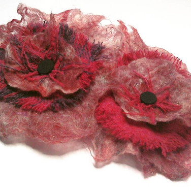 Red flower felt corsages with Harris Tweed. Available from Handmade at the Scottish Wool Centre, Aberfoyle.