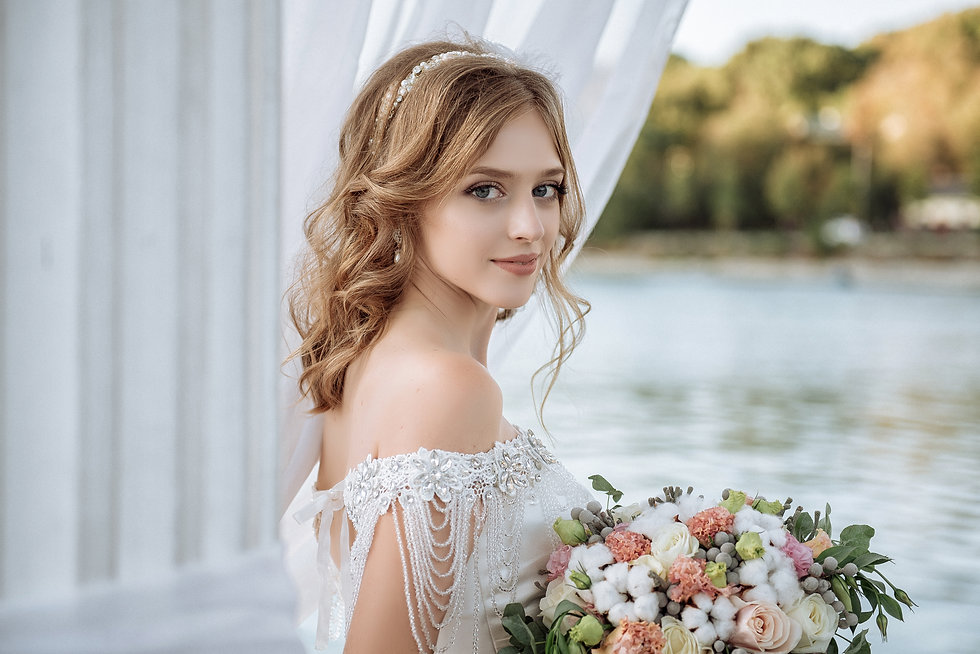 Beautiful bride with wedding flowers bouquet, attractive woman in wedding dress. Happy new