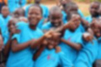 BEST- girls smiling at Mbuya-min.jpg