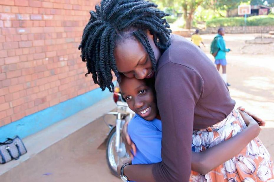 STAFF SPOTLIGHT: Meet Joan Atimango, Compassionate Trainer and Singer