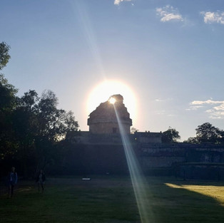 Sun rising behind the observatory