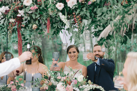 Covered in Flowers Tent Toast to the Bride & Groom at Blackstone Rivers Ranch