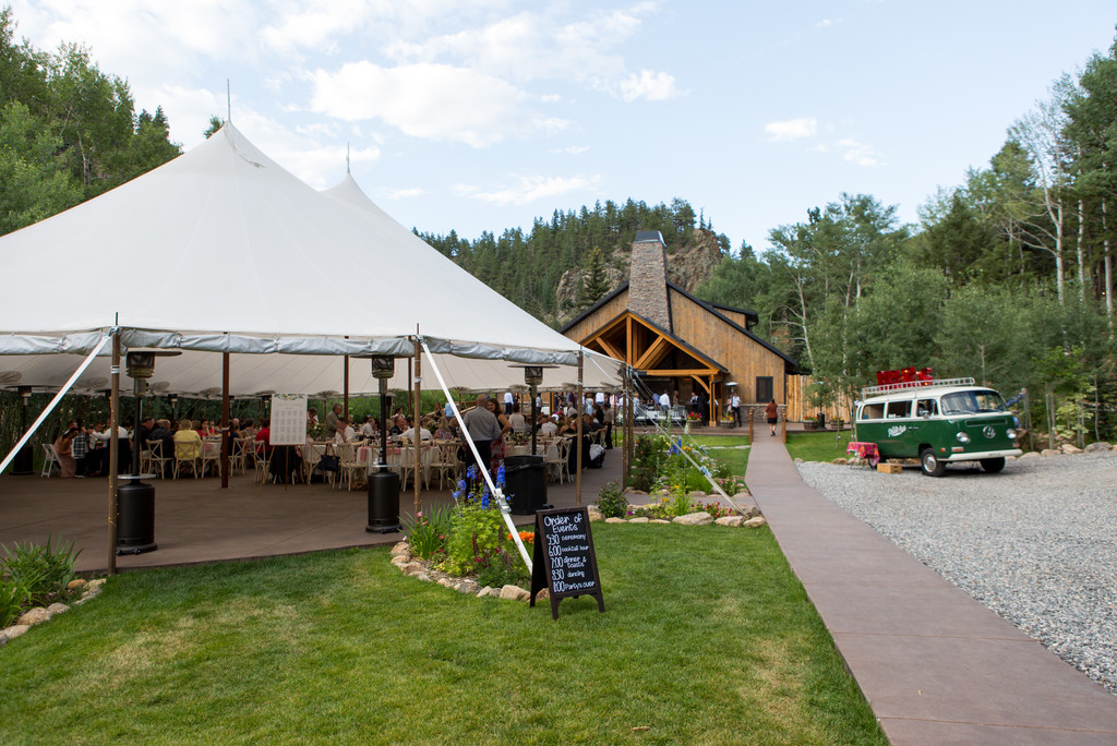 View of the tented wedding and photo bus