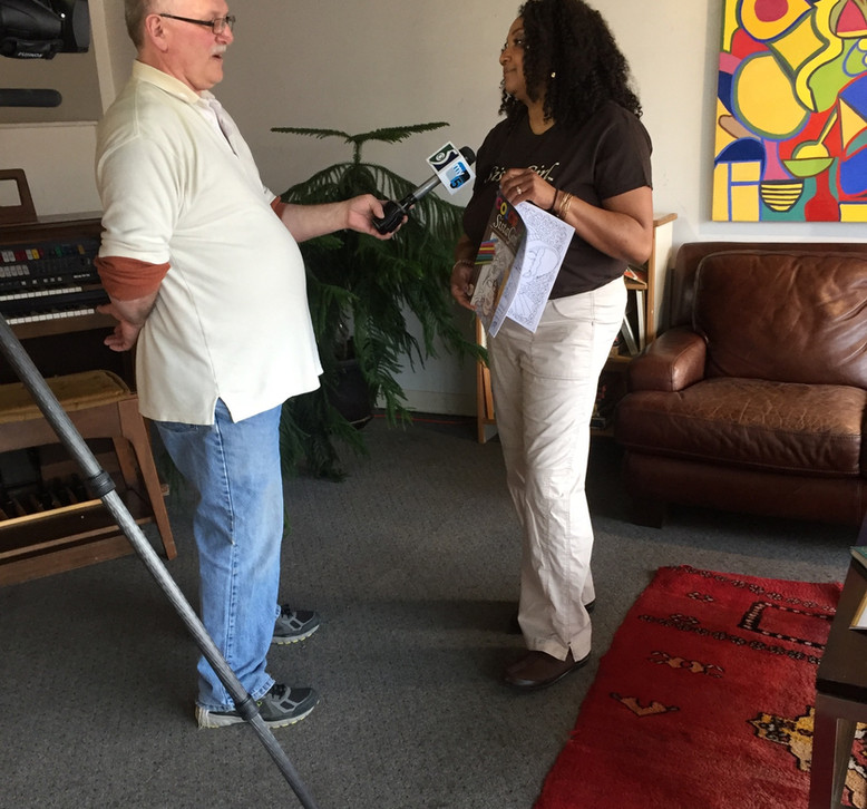 Being interviewed by a local TV station.
