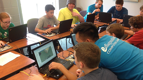 Camp counselors teaching Minecraft World Design at Emagination Tech Camp