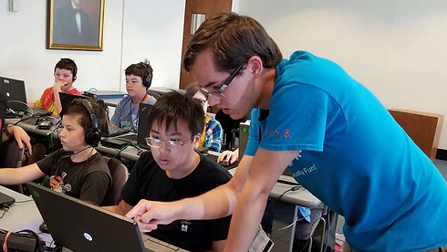 Tech Campers learning how to code in C# at coding camp