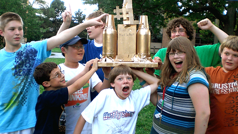 Emagination Tech Campers holding the golden award