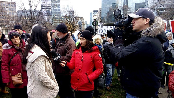 Alice being interviewed at March for Jobs, Justice, and Climate 2015