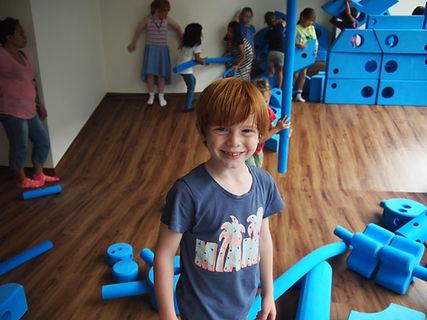 Johnny having fun in an indoor playgroud