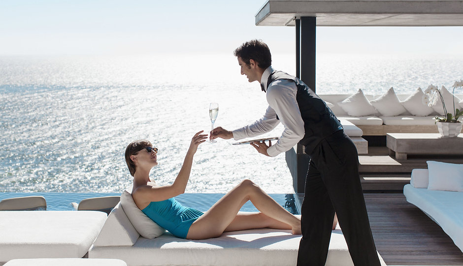 Waiter Serving Wine with Ocean View