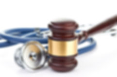 brown gavel and a medical stethoscope.jp