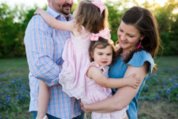 cute family in a field