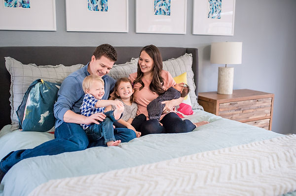 family photo with newborn bed