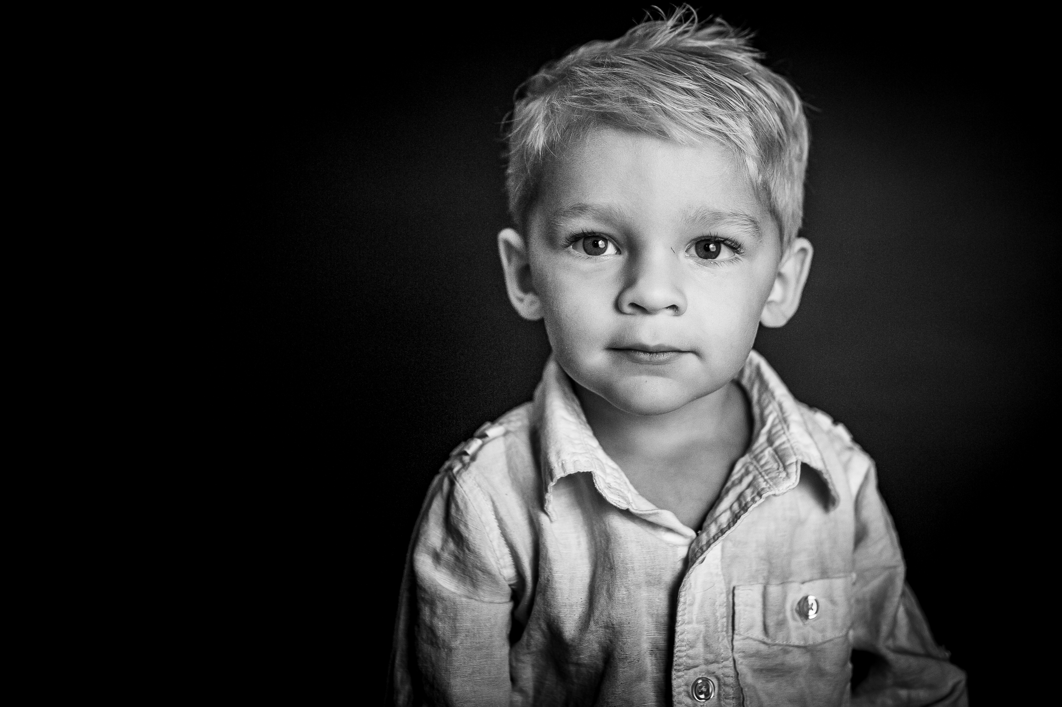 blonde boy with serious face