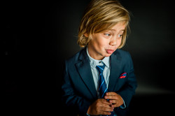 blonde boy in suit with tie