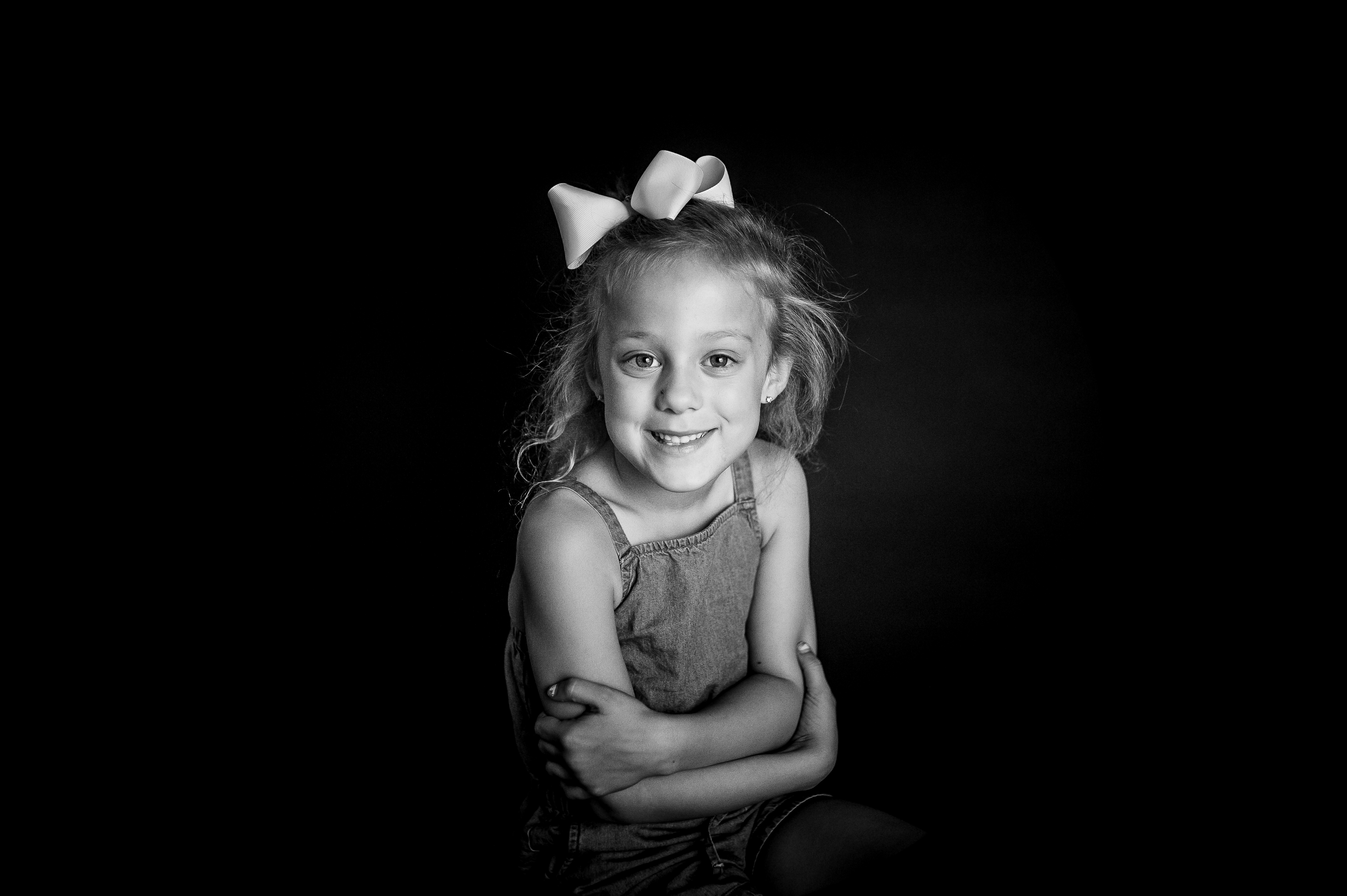 girl with blonde hair and bow