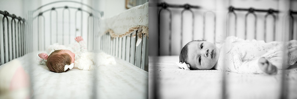 baby girl in antique crib