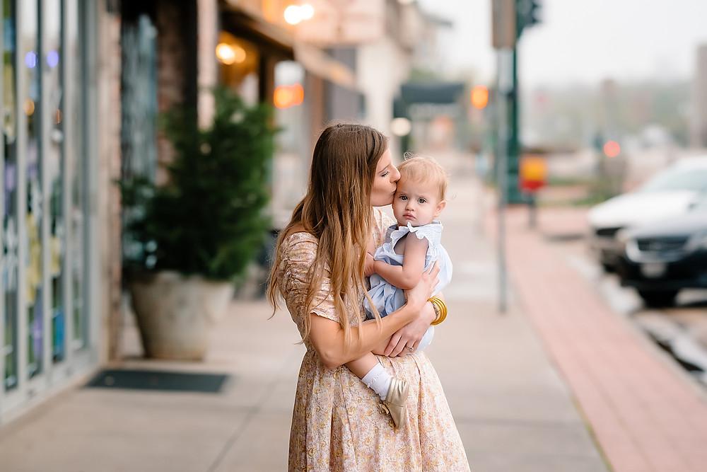 Mom holding baby Denton square