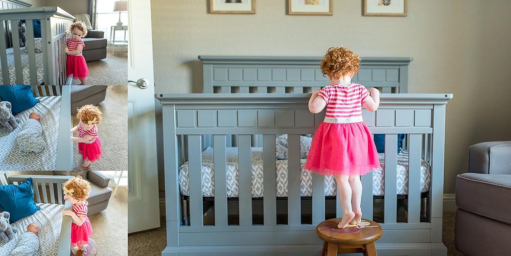 sister looking into baby's crib, new big sister