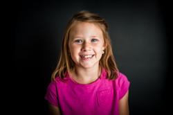 smiling girl in pink shirt