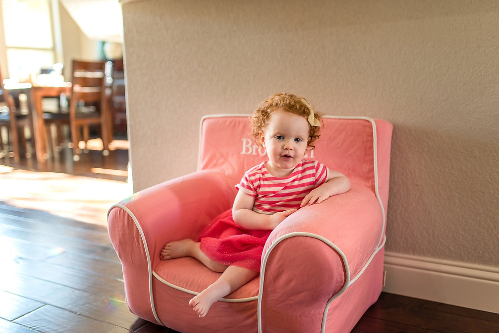 red headed girl in chair